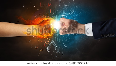 Fighting hands breaking glass with fire and water  Stock photo © ra2studio