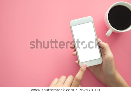 Closeup hands using smartphone mockup at the office desk. stock photo © ijeab