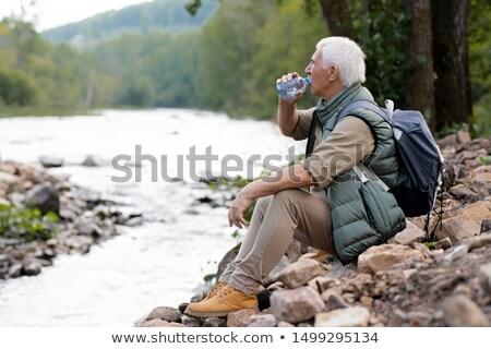 Stanco maturo zaino in spalla acqua potabile plastica bottiglia Foto d'archivio © pressmaster