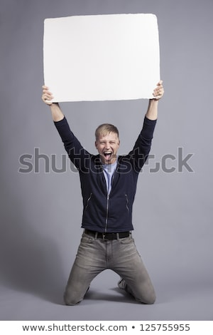 Friendly man showing white blank panel. Stock photo © lichtmeister