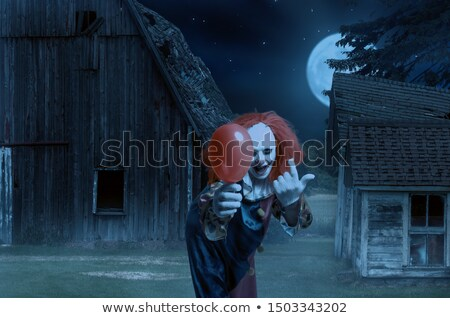 scary evil clown with a red balloon Stock photo © nito