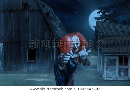 Scary kwaad clown Rood ballon Stockfoto © nito