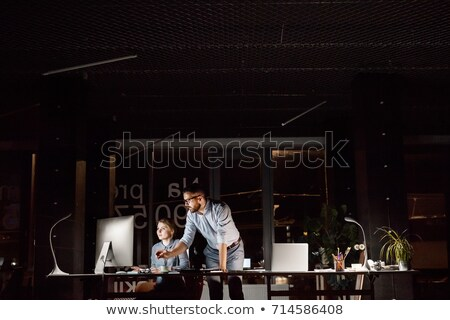 tired businessman working late at night office Stock photo © dolgachov