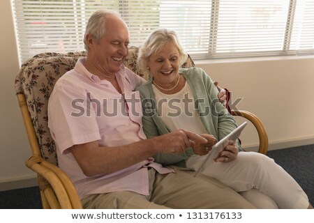 Vue couple de personnes âgées rire numérique comprimé Photo stock © wavebreak_media