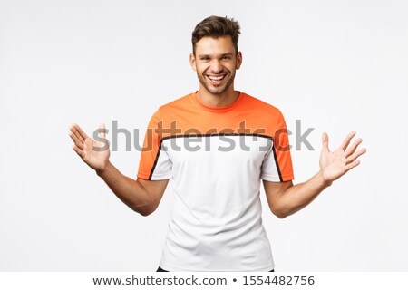 Guy telling about huge giveaway, introduce big amazing product, smiling happy and excited. Masculine Stock photo © benzoix