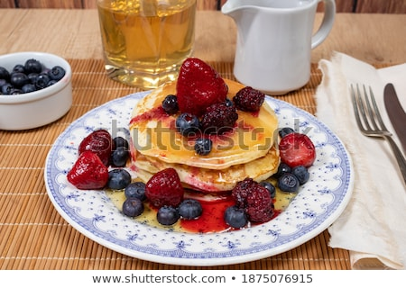 freshly prepared crepes with maple syrup stock photo © danielgilbey