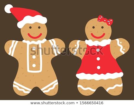 Gingerbread man kurabiye noel baba şapka sevimli Stok fotoğraf © robuart