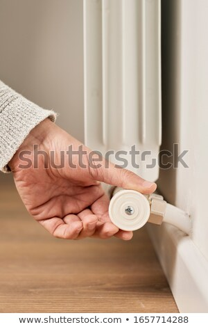 man rotating the valve of a radiator Stock photo © nito