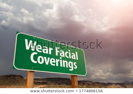 Coronavirus Green Road Sign Against Ominous Stormy Cloudy Sky Stock photo © feverpitch