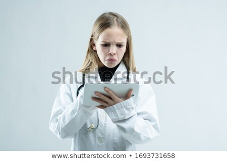 Jovem jaleco clipboard branco médico enfermeira Foto stock © Giulio_Fornasar