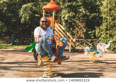 Felnőtt férfi fából készült hintaló jókedv boldog Stock fotó © GVS