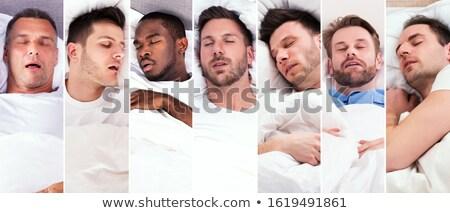 Moe jonge man snurken diep slapen Stockfoto © AndreyPopov