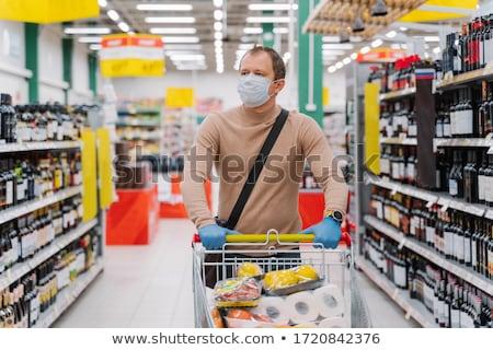 горизонтальный выстрел человека супермаркета товары Сток-фото © vkstudio