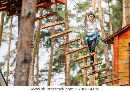Fiatal vonzó nő kaland kötél park biztonsági berendezés Stock fotó © galitskaya