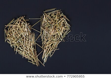 Heart shape made up by steel nail Stock photo © Ansonstock