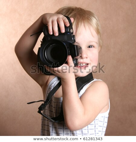 Little boy photographer with slr camera Stock photo © pekour