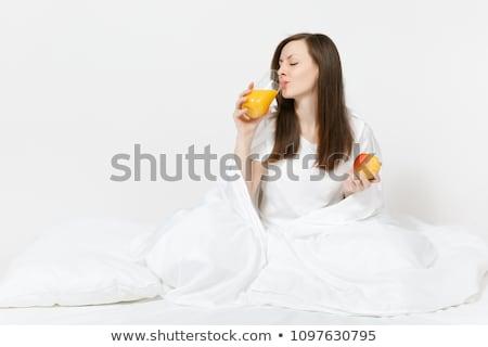 jonge · mooie · vrouw · appel · bed · ochtend · vrouw - stockfoto © HASLOO