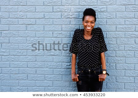 Beautiful girl by the brick wall stock photo © pekour