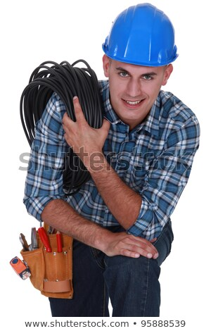 Worker carrying cabling coiled around his shoulder Stock photo © photography33