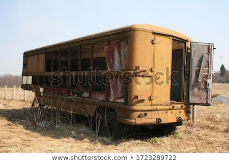 an old abandoned vintage delivery truck van in a field stock photo © jeremywhat
