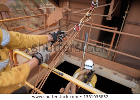 two hands while rope pulling Stock photo © prill