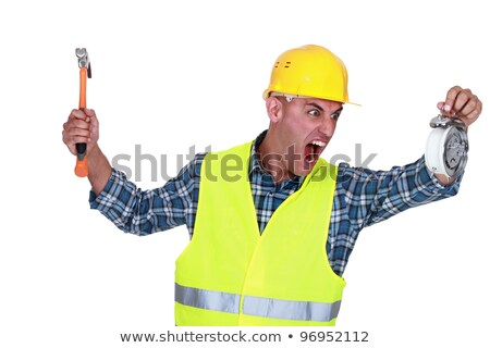 Angry tradesman looking at the time Stock photo © photography33