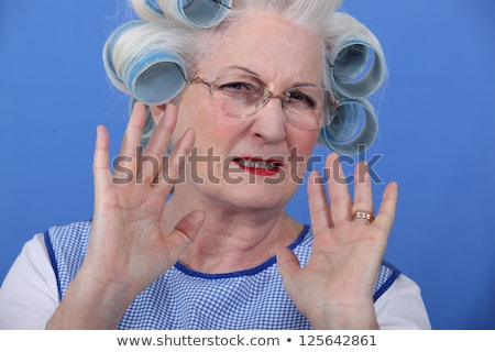 Elder upset with curlers in her hair Stock photo © photography33