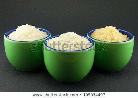 Three varieties of rice in three small green cups Stock photo © Armisael