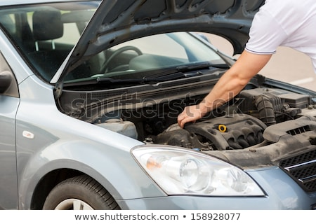 Man looking under car bonnet Stock photo © photography33