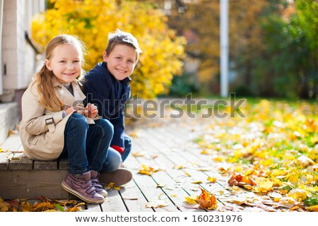 small girl in sunny autumn day stock photo © anna_om