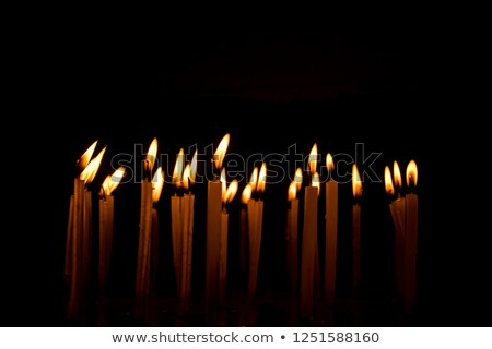 Zdjęcia stock: Tea Candle In Front Of Many Tea Candles