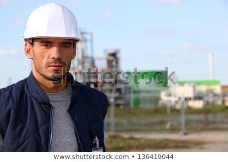 серьезный · работник · глядя · изолированный · строительство - Сток-фото © lisafx