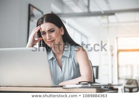 woman crying on computer stock photo © smithore