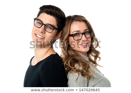 Adorable young couple posing back to back stock photo © stockyimages