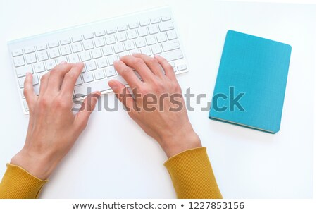 Stock photo: Female hand holding up the letter A from the bottom