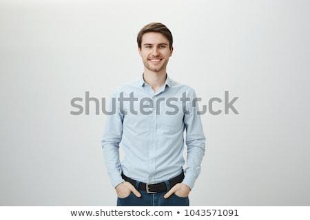 Porträt grinsend junger Mann isoliert weiß Hände Stock foto © acidgrey
