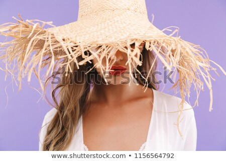Woman hiding wearing a big brown hat stock photo © photography33