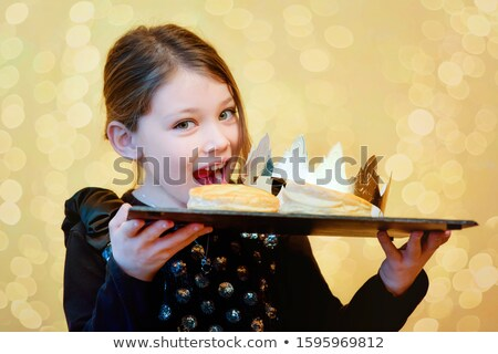 Girls celebrating the Epiphany with a 'Galette des Rois' Stock photo © photography33