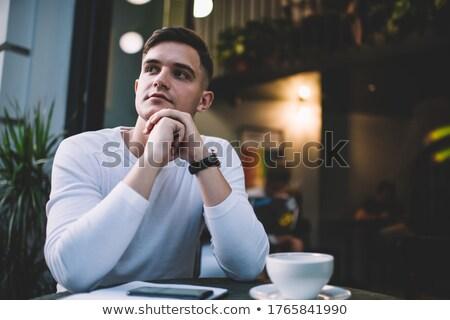 Paisible réfléchissant homme toucher menton portrait Photo stock © pablocalvog