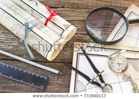 Old Maps in rolls with tools for navigation stock photo © gavran333