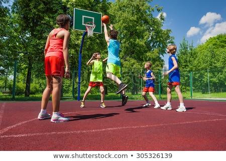 Kinderen spelen basketbal silhouetten schieten Stockfoto © koqcreative