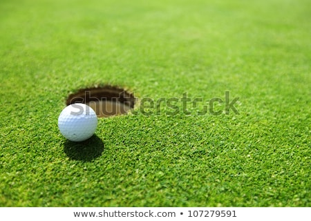 Stock photo: golf ball on lip