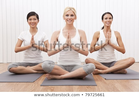 young woman with crossed legs in praying position stock photo © wavebreak_media