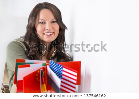portrait of a lovely young woman with different countries flags stock photo © hasloo