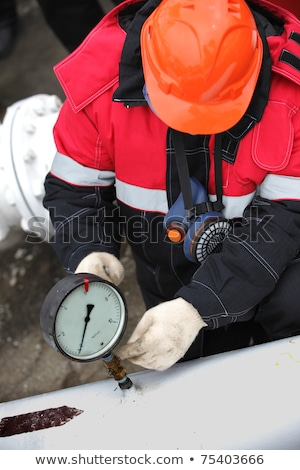 oil worker with pipe wrench working stock photo © goce