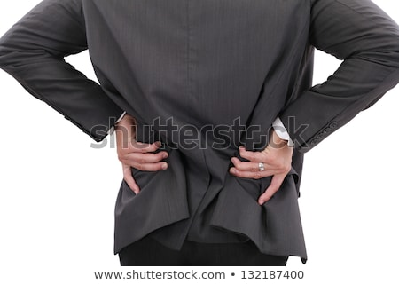 young businessman having some lower back pain stock photo © dacasdo