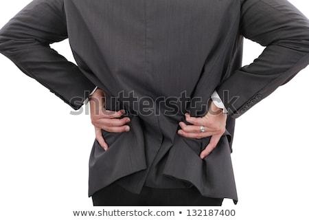 pijnlijk · Maakt · een · reservekopie · achteraanzicht · jonge · man · aanraken · hand - stockfoto © dacasdo