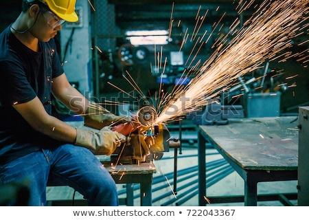 manual worker with grinder stock photo © tiero