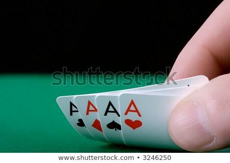 Jogador mão quatro aces papel coração Foto stock © sqback