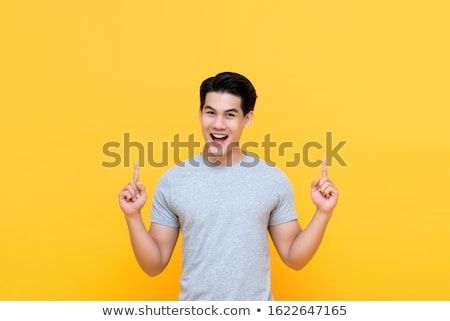 asian man arms opened looking up stock photo © szefei